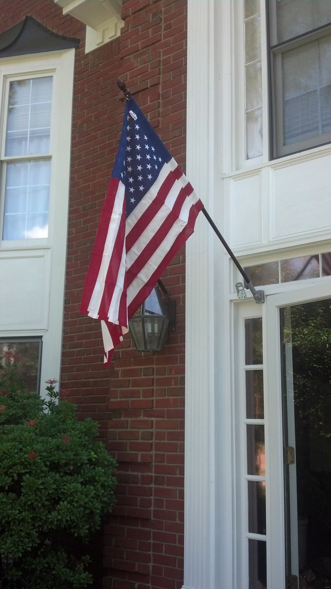 Hanging A New American Flag On Day Greg Hoffman